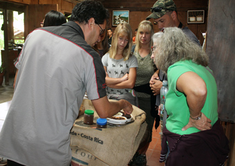 Junior giving a coffee tour in Monteverde Costa Rica