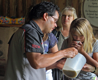 Tasting Sugar Cane Juice on Don Juan Coffee Tour Monteverde